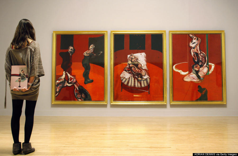 A visitor admires a triptych by Irish bo